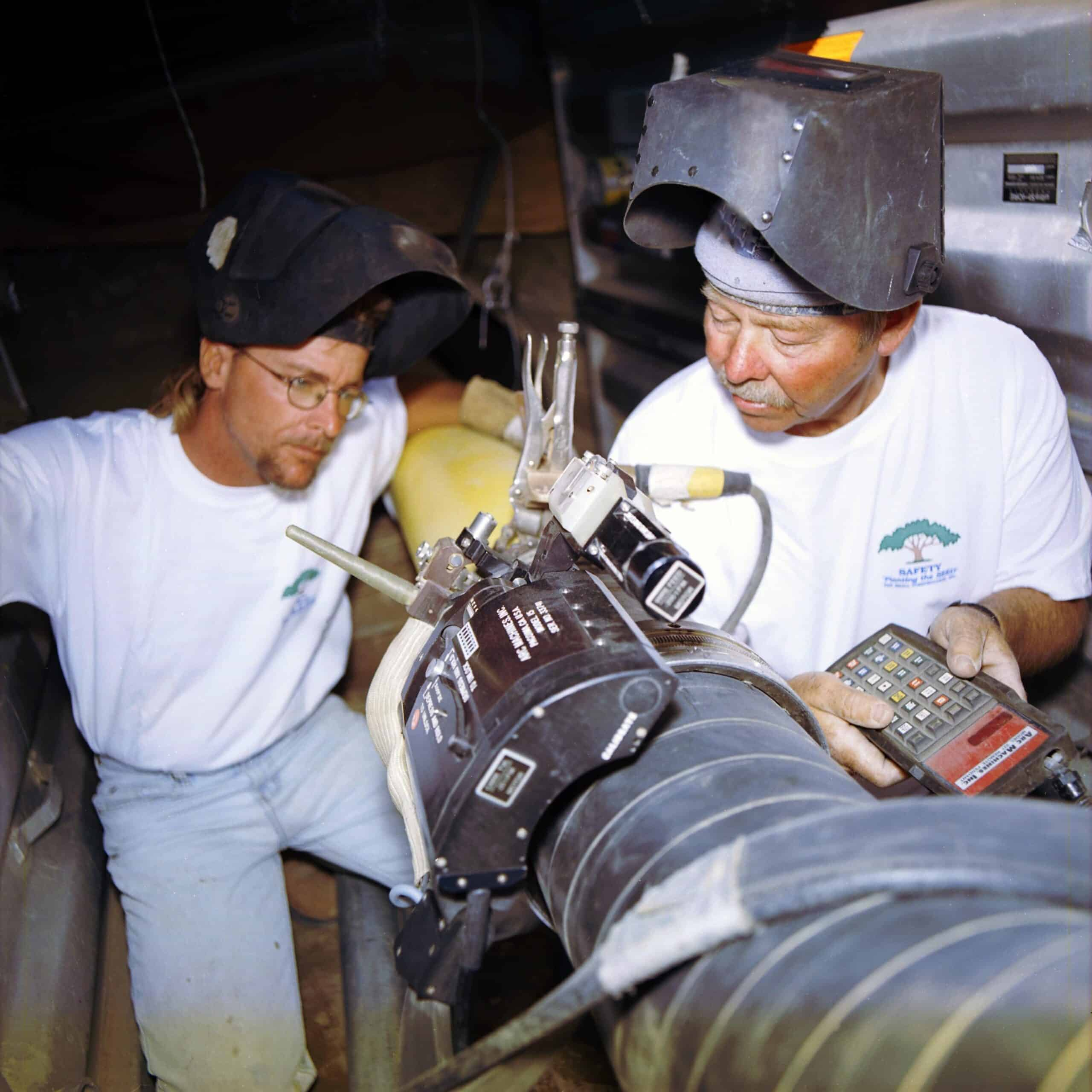 Remote welding control units being used to adjust orbital welding while in progress.