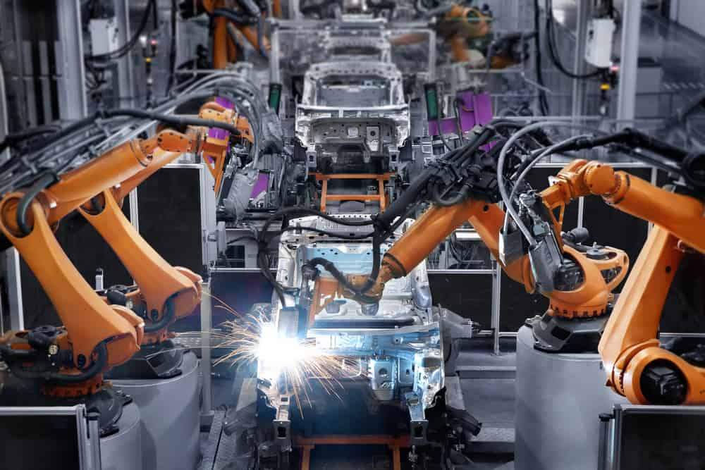 Robotic welding systems at work in factory